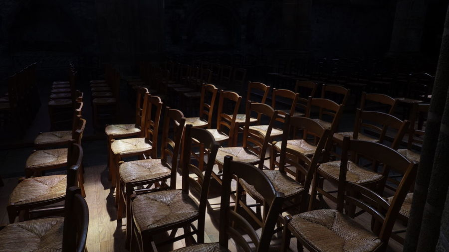 Empty Chairs In Dark Room