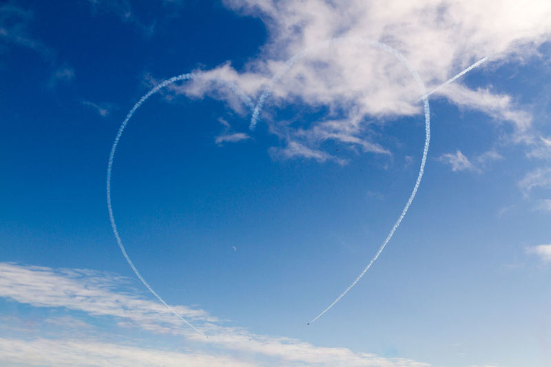 Acrobatic Flight Adventure Air Festival Air Show Beauty In Nature Blue Cloud Cloud - Sky Day Heart Low Angle View Mid-air No People Outdoors Red Arrows Red Arrows Air Display Skill  Sky Smoke Smoke Trails Teamwork Two Is Better Than One