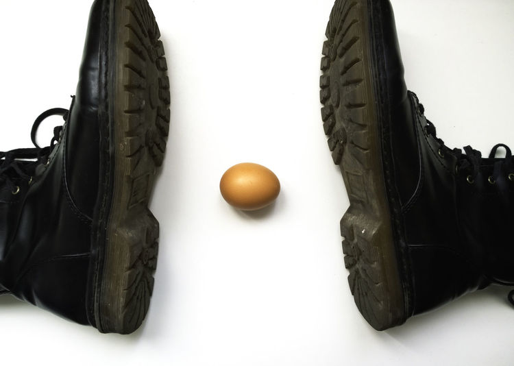 boots smashing an egg Basket Black Color Boots Shoes Close-up Egg Heap Medium Group Of Objects No People Part Of Shoes Smash  Smashing Still Life Studio Shot White Background