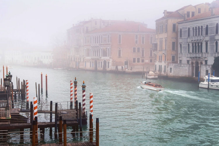 venice italy channel street between buildings foggy weather Water Building Exterior Architecture Built Structure Nautical Vessel Transportation Waterfront City Nature Mode Of Transportation Canal Day Building Fog Travel Destinations Travel Outdoors Tourism Post Wooden Post No People Venice, Italy