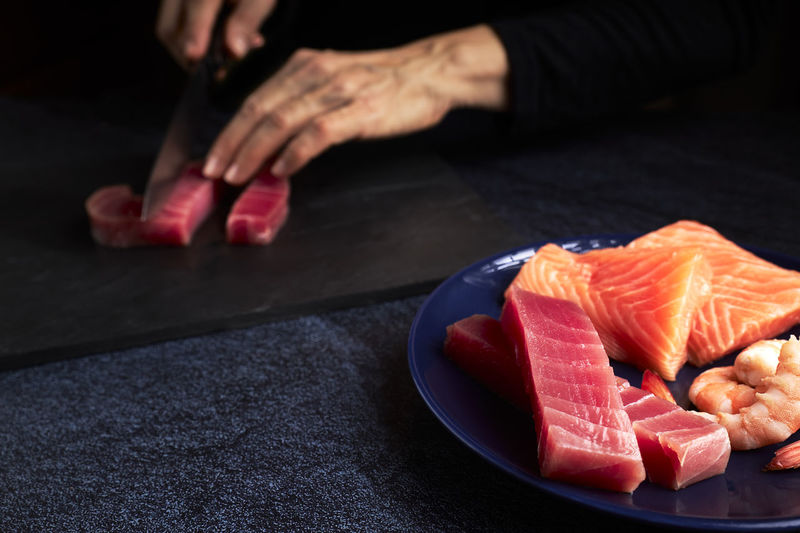 High angle view of person preparing food on cutting board