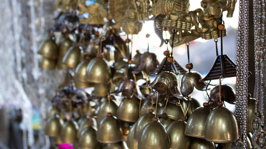 Close-up of wind chimes hanging for sale at store