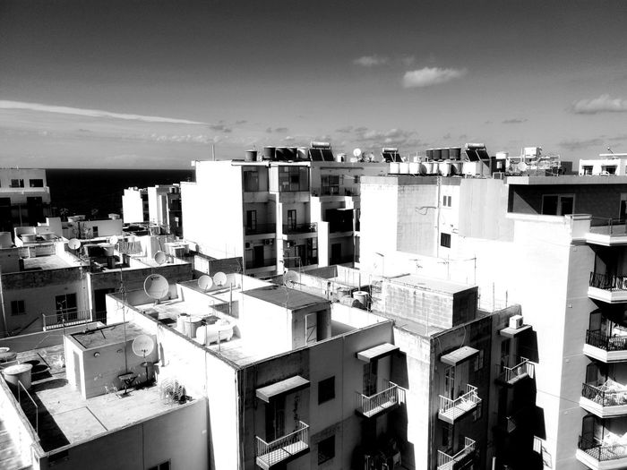 City Cityscape Ghetto Crowded Sky Architecture Building Exterior Built Structure Residential District Row House Tiled Roof  Tall - High Office Building TOWNSCAPE