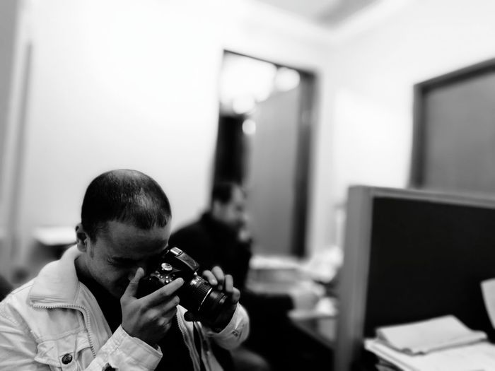 Man Photographing In Medical Clinic