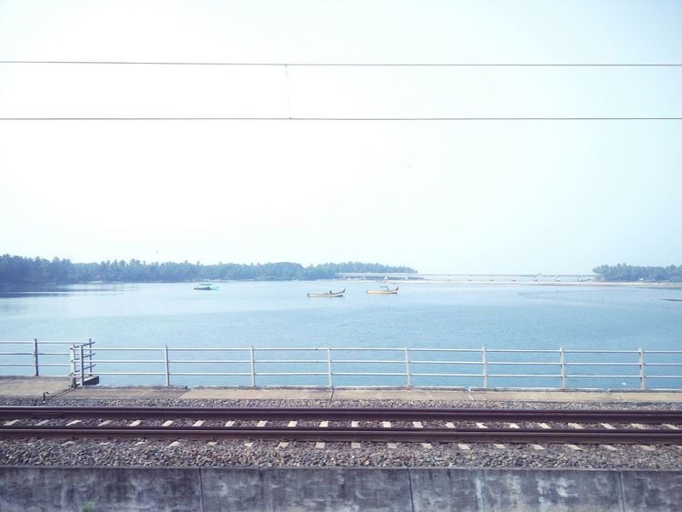 crossing Kadalundi River on a train in central Kerala, at it's Delta into the Arabian Sea. Train #journey #travelphotography #southindia #kerala #water #Delta #ArabianSea #bridges Bird Water Sea Electricity  City Sky Animal Themes Horizon Over Water