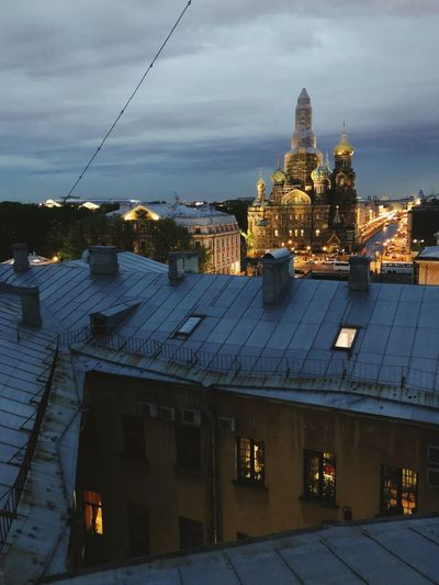 View of the roofs of St. Ptersburg. Savior on Spilled Blood. Evening view of the city. Roof Savior On Spilled Blood Architecture Evening Light Evening Sky Evening View Of The City St. Petersburg, Russia Санкт-Петербург Architecture Building Exterior Built Structure Building City Sky My Best Photo Window Cloud - Sky Travel Destinations