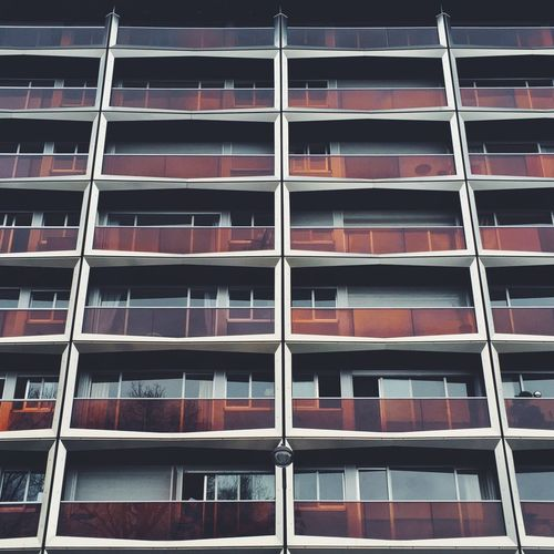 Balcons. Building Exterior Architecture Window Built Structure Low Angle View Balcony Outdoors City Full Frame Day No People Modern Fire Escape Minimalist Architecture