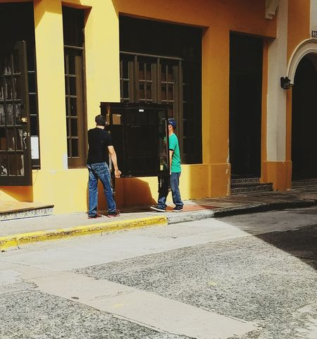 Architecture Standing Men Real People Lifestyles City Light And Shadow Urban Exploration Architectural Detail San Juan PR Popular City Life Yellow Stories From The City Visual Creativity Focus On The Story The Street Photographer - 2018 EyeEm Awards #urbanana: The Urban Playground #urbanana: The Urban Playground