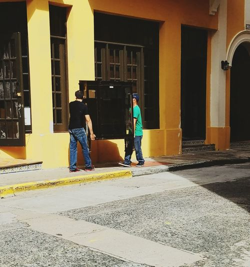 Architecture Standing Men Real People Lifestyles City Light And Shadow Urban Exploration Architectural Detail San Juan PR Popular City Life Yellow Stories From The City Visual Creativity Focus On The Story The Street Photographer - 2018 EyeEm Awards #urbanana: The Urban Playground #urbanana: The Urban Playground Human Connection