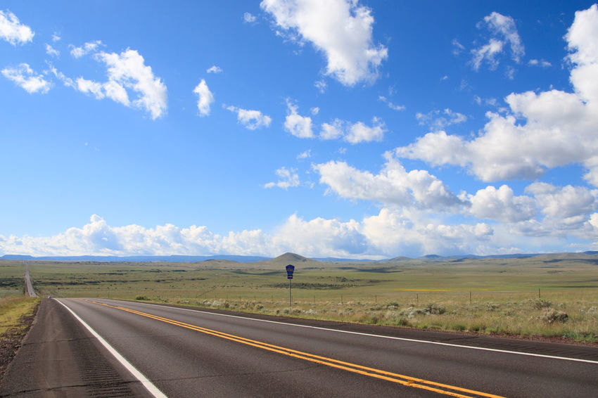 Long road through countryside Arizona Blue Cloud - Sky Country Road Day Diminishing Perspective Empty Highway Horizon Over Land Journey Landscape Long Long, Straight Road Nature No People Outdoors Road Road Marking Route 191 Scenics Sky The Way Forward Feel The Journey Transportation Vanishing Point