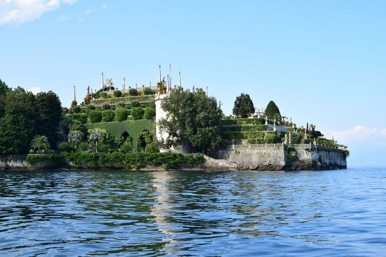 Low angle view of castle by lake maggiore