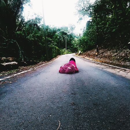 Lay down on the road