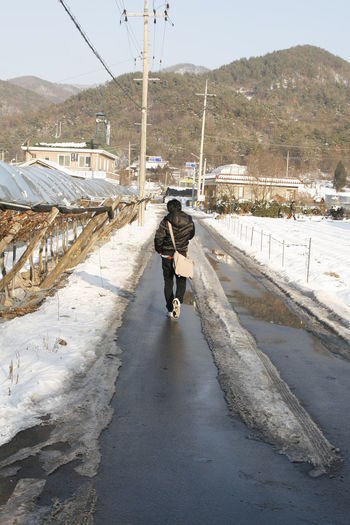 you will never walk alone One Person Rear View Full Length Transportation Walking Real People Mountain Winter Lifestyles Architecture Road Nature Built Structure Snow Leisure Activity Cold Temperature Outdoors The Way Forward