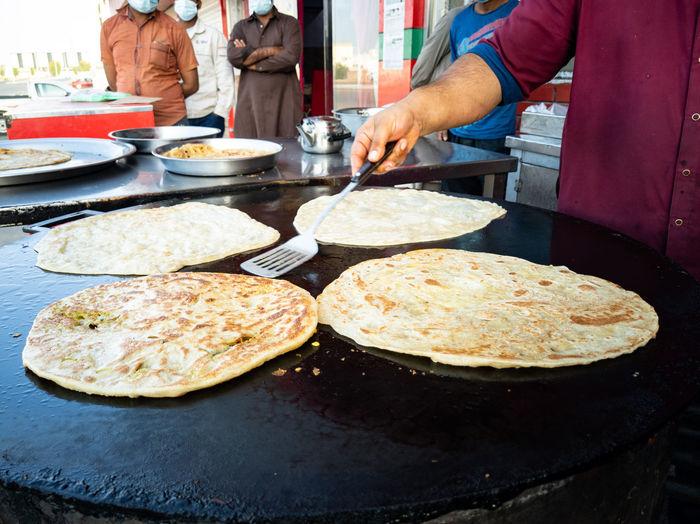 People preparing food on table