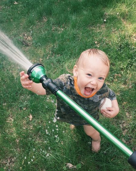 Boys Childhood Cute Excitement Fun Grass Hose Innocence Leisure Activity Outdoors Playful Playing Spray Sprinkler Enjoy The New Normal