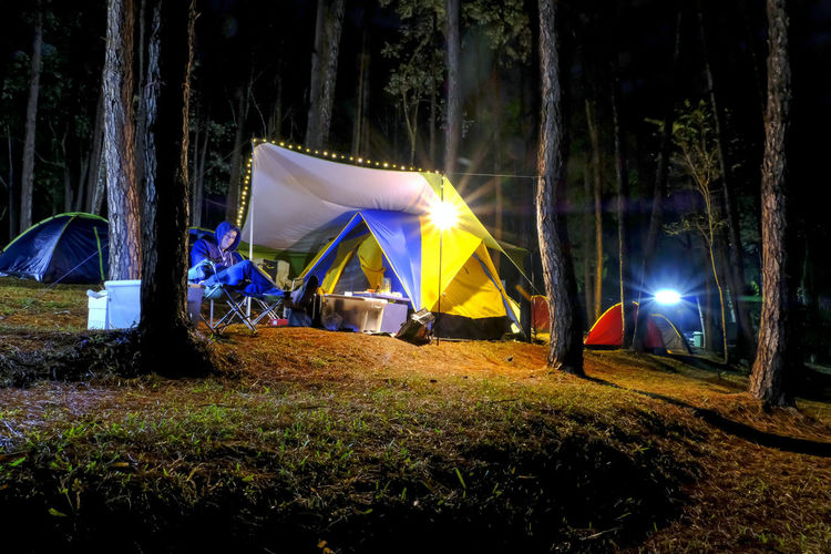 View of tent in field at night