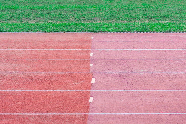 Sport Grass Day No People Running Track Track And Field High Angle View Nature Absence Green Color Outdoors Red Competition Competitive Sport Field Tennis Full Frame Brown Plant Single Line Dividing Line Yard Line - Sport Minimalist