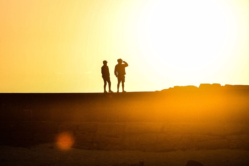 Sunset Sky Two People Silhouette Men Real People Togetherness Leisure Activity Lifestyles Nature Beauty In Nature Orange Color Copy Space Standing Tranquility Tranquil Scene Scenics - Nature Bonding People Land Positive Emotion Couple - Relationship Outdoors