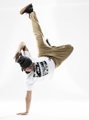 Breakdance Breakdancer Breakdancing Casual Clothing Day Energetic Exercising Full Length Hip Hop Jumping Leisure Activity Lifestyles Motion Multiple Image One Person People Real People Skill  Studio Shot White Background Young Adult Young Women