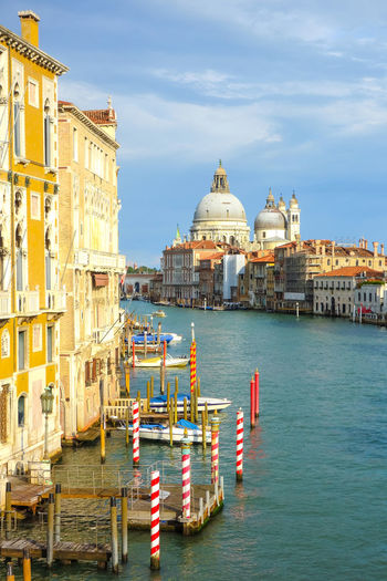 Grand canal by santa maria della salute against sky