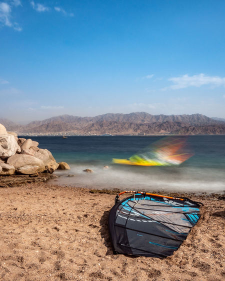Eilat Israel Water Nautical Vessel Beach Scenics - Nature Transportation Mode Of Transportation Mountain Rowboat Tranquil Scene Cloud - Sky Surf Long Exposure Sea Beauty In Nature Tranquility Sand Nature