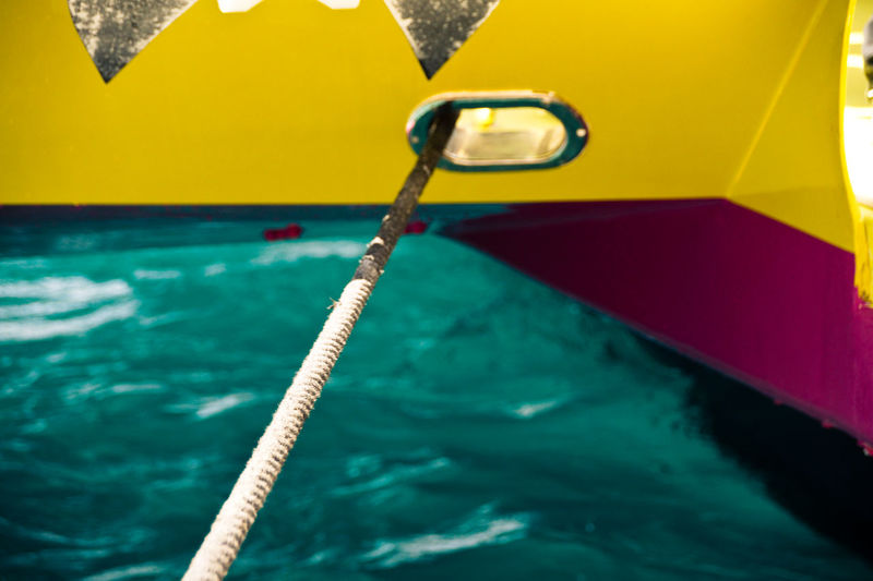 High angle view of rope at boat moored in sea