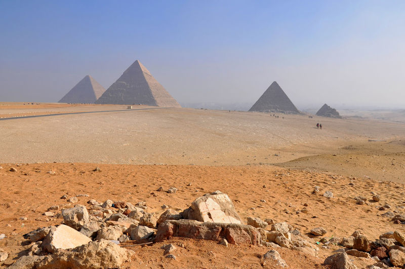 Scenic view of pyramids in desert against sky