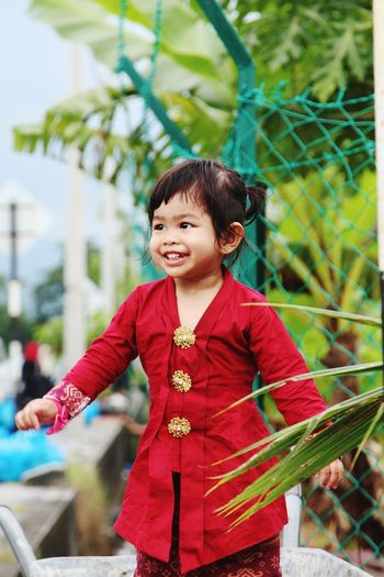 Black Hair One Person Child Smiling Red Girls Children Only People One Girl Only Cute Outdoors Front View Cheerful Portrait Childhood Tree Happiness Looking At Camera Student Girl Smile ✌ Kebayainspiration Kebaya Malaysia Malay