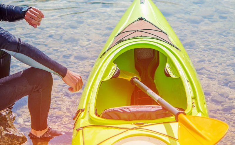 Adult Adults Only Car Close-up Collector's Car Day Human Body Part Human Hand Human Leg Kayak Kayaker Low Section One Person One Woman Only One Young Woman Only Outdoors People Sport Summer Vacations Young Adult