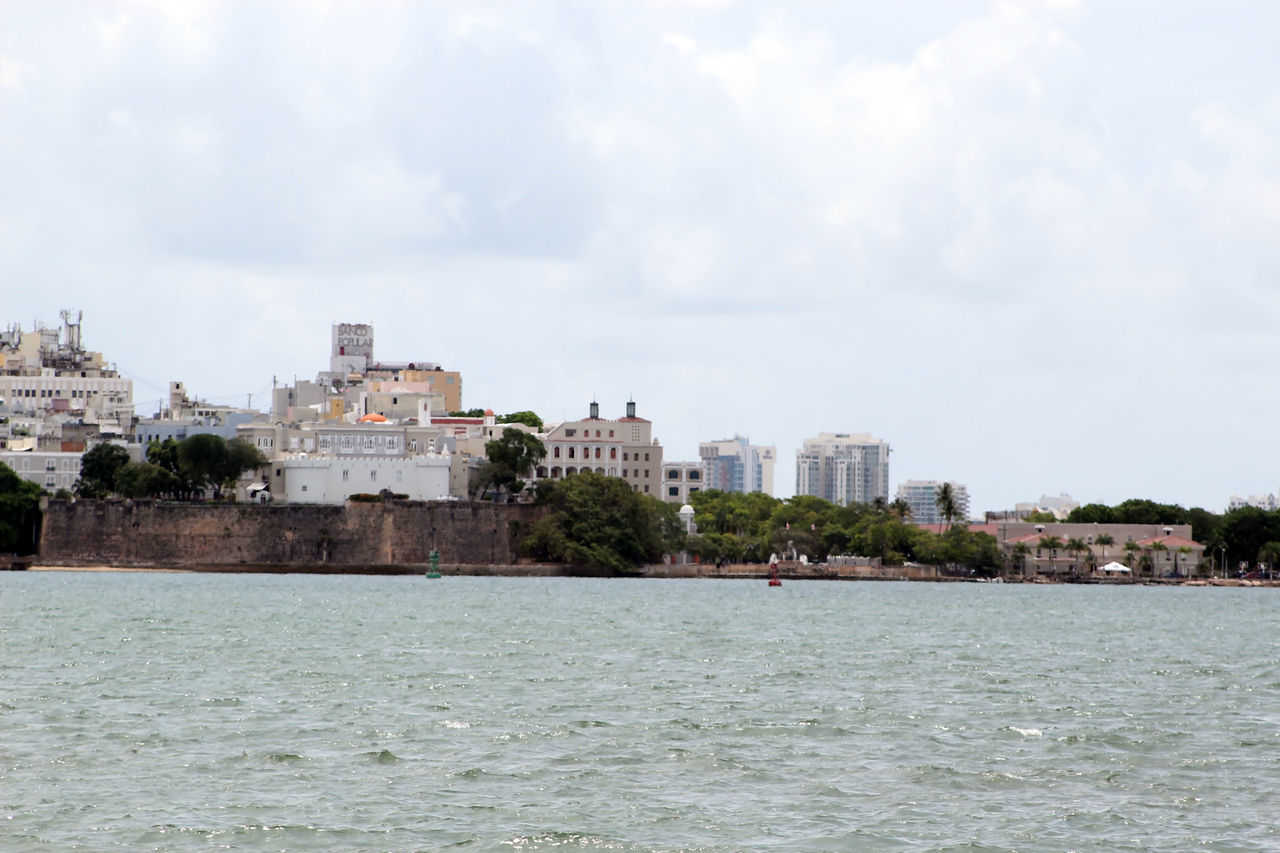 The old and the new San Juan Architecture Beauty In Nature Building Exterior Built Structure City Cityscape Cloud Cloud - Sky Cloudy Day Nature No People Outdoors Overcast Residential Building Residential District Rippled River Scenics Sky Tranquil Scene Tranquility Travel Destinations Water Waterfront