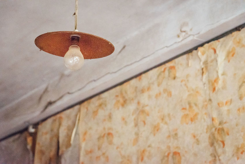 Abandoned Urbex Old Low Angle View No People Wall - Building Feature Close-up Ceiling Focus On Foreground Hanging Built Structure Architecture Day Bathroom Wall Indoors  Selective Focus Nature House White Color Electricity  Wood - Material Lighting Equipment Light Bulb Historic Rusty Worn Out Obsolete Pendant Light