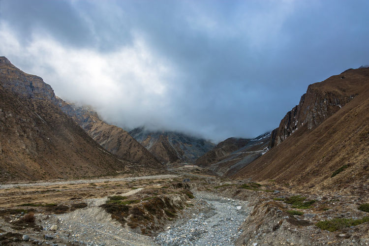 Beautiful mountain landscape in the vicinity of Muktinath, Nepal. Beauty In Nature Climate Cloud - Sky Day Environment Formation Land Landscape Mountain Mountain Peak Mountain Range Nature No People Non-urban Scene Outdoors Remote Road Rock Scenics - Nature Sky Tranquil Scene Tranquility Water