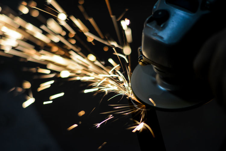 Close-up of welder working in factory