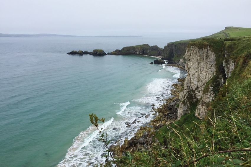 Hach, Irland! Northern Ireland Coast Carrick-a-rede Sea Water Cliff Beauty In Nature Idyllic Rock - Object Solitude Coastline Rock Formation Seascape Travel Destinations Tranquility Remote Horizon Over Water Green