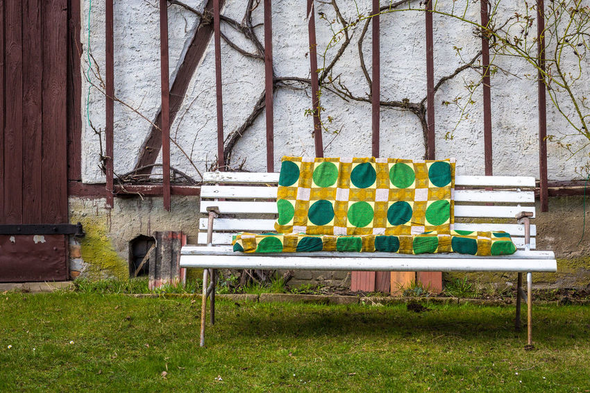 Abstract Architecture Barn Bench Blanket Cover Day Grandmas Garden Grass Green Color Nature No People Old Old Fashioned Outdoors