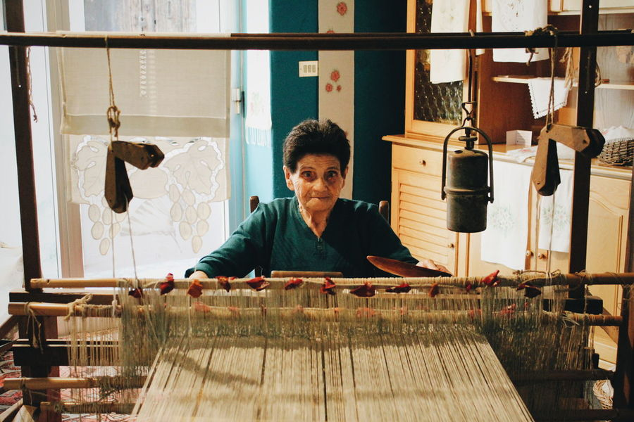 Weaving Machine One Person Adult Business Front View Indoors  Art And Craft Waist Up Skill  Real People Portrait Small Business Craft Business Finance And Industry Working Workshop Creativity Occupation Looking At Camera Expertise Preparation  Small Business Heroes