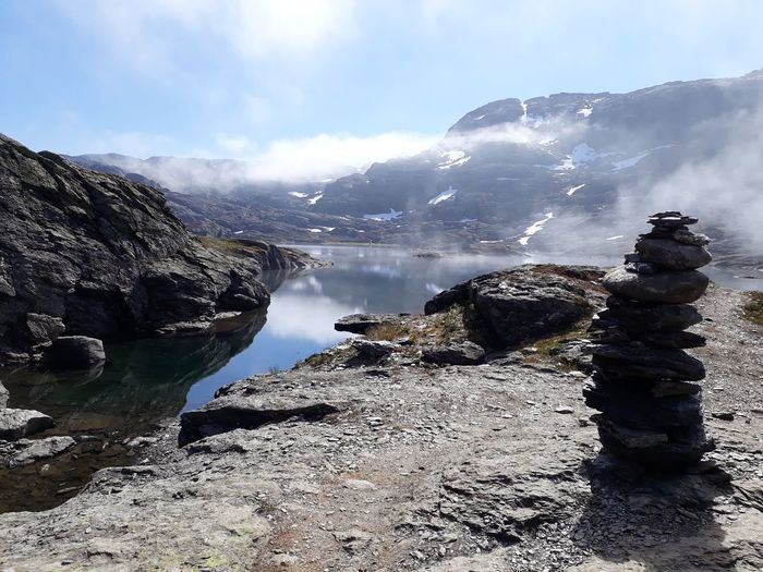 lonely tower by the lake Mountain Lake Norway Stone Tranquility Quiet Moments Non-urban Scene Hike Trolltunga Water Mountain Sky Cloud - Sky Landscape