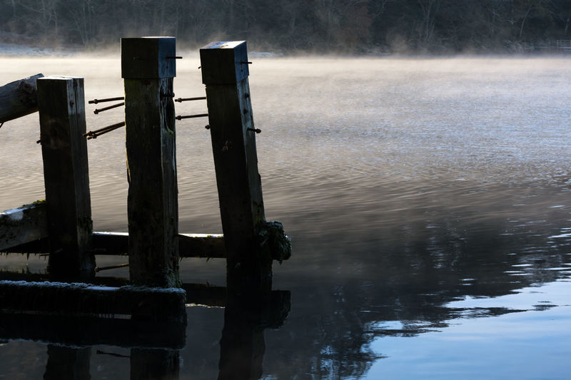 A broken pier at Balmaha surrounded by morning mist rising from Loch Lomond Water Wooden Post Wood - Material Outdoors Tranquility No People Lake Day Landscape Nature Sky Pier Broken Mist Loch Lomond Trossachs National Park Freshwater Morning Sunrise Picturesque Rural Decaying Wood Still Calm Peaceful