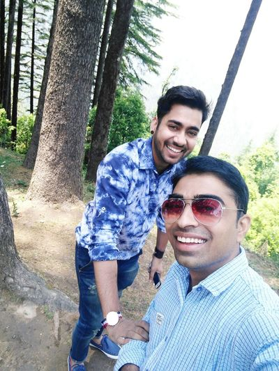Selfi time with naresh Smiling Portrait Looking At Camera Two People Togetherness Men Happiness Day Tree Young Men Cheerful Standing Adult Bonding Outdoors People Young Adult Adults Only Selfie Only Men