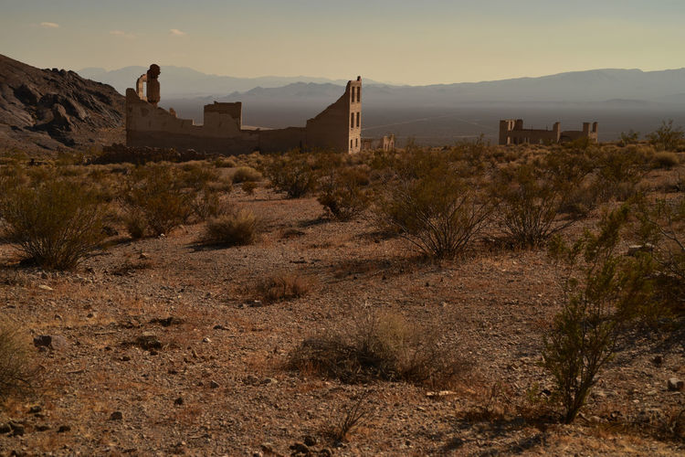 The former town of rhyolite in nevada is now a deteriorating ghost town