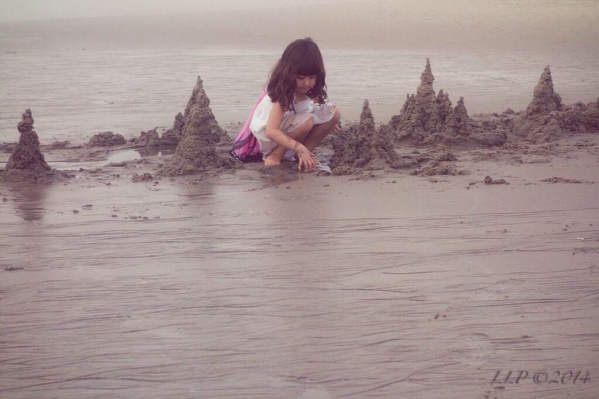 People Building A Sand Castle Beachphotography Life Is A Beach Fog Julia On The Beach Candid Portraits