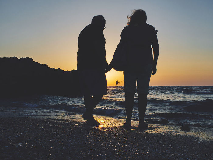 Two People Togetherness Silhouette Love Sunset Beach Water People Sea Lifestyles The Week On EyeEm