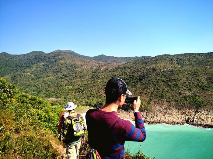 HongKong Sai Kung Hiking Hikingadventures Discover Your City Discover Hong Kong Secret Beach Blue Sky Hong Kong EyeEm Selects Photography Themes Photographing Camera - Photographic Equipment Technology Wireless Technology Photo Messaging Digital Camera Landscape Clear Sky Adventures In The City