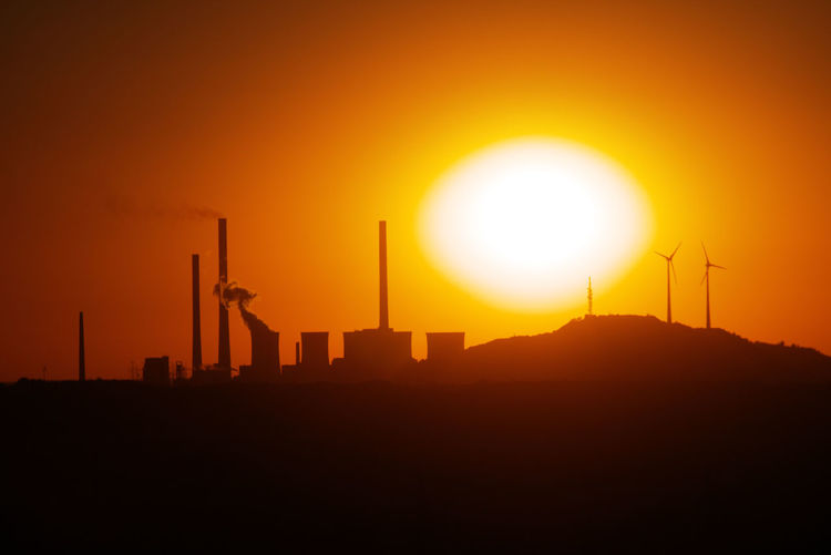 Silhouette Of Power Station At Sunset