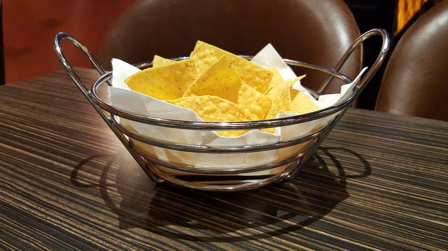 """Chips"", prepping for my main course at El Mazatlan, Bowling Green, KY. Food Ready-to-eat Freshness Close-up Snack No People Crunchy Nacho Chip Nacho Nachos Nachos Time Galaxy S6 Edge Unhealthy Eating Food And Drink Indoors  Bowl"