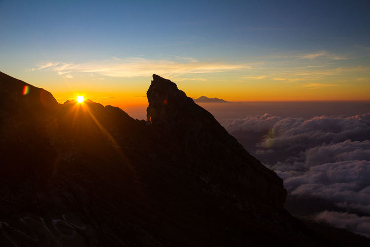 Nice sunrise in Mount Agung Bali Agung Agung Volcano Volcano Bali Sunrise Sky Sunset Beauty In Nature Scenics - Nature Mountain Tranquil Scene Cloud - Sky Tranquility Nature Non-urban Scene Idyllic Mountain Range Orange Color Rock Sun Environment Rock - Object Landscape Solid No People Mountain Peak Outdoors Formation