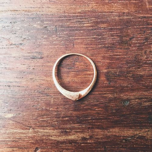 Close-up of ring on wooden table