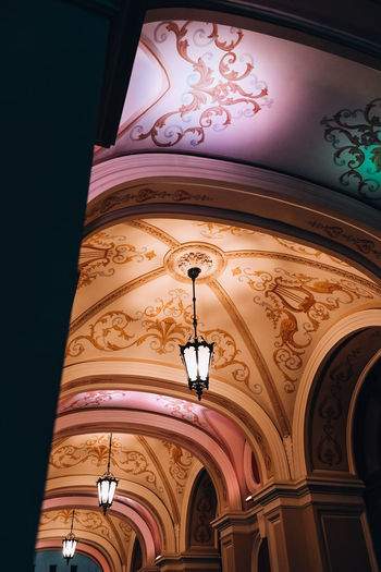 Low angle view of illuminated lamp in building