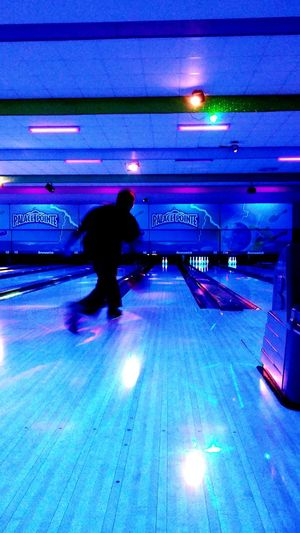 Capturing Motion Vertical Full Length People Neon Indoors  Adult Bowling Bowling Alley Cosmic Bowling Cosmicbowling Family Time Family Fun Game Bowlingnight Bowlingalley Bowling Balls Blacklight UV Light Glow Blur Blurred Motion Motion Capture Motionblur Motion Blur
