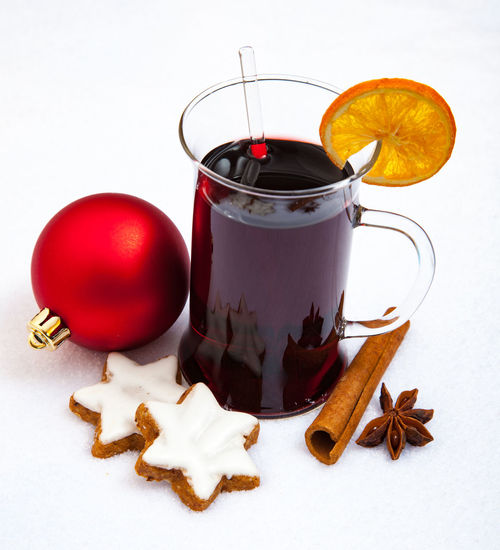 High angle view of mulled wine and food on snow